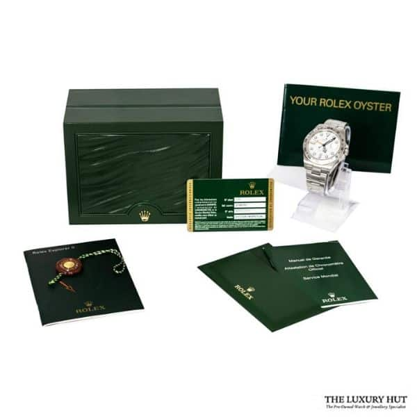 rolex watch box and paper