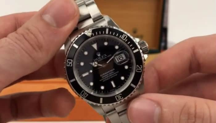 pre-owned rolex submariner 16600